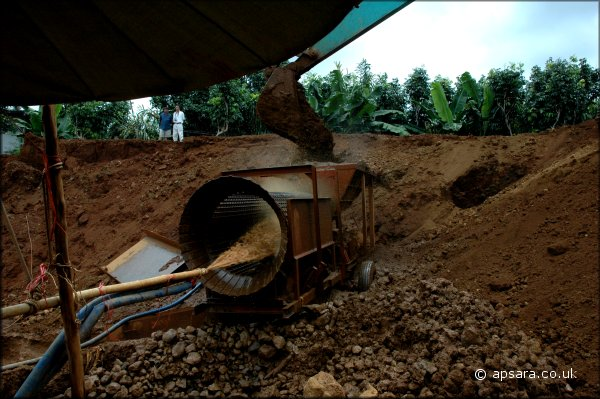 Tipping soil into the rotating drum.