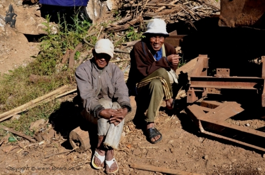 Two miners taking a break from ruby mining at Ah-Sein-Taw, Mogok