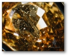 Zircon particle inclusions in Madagascan yellow sapphire.